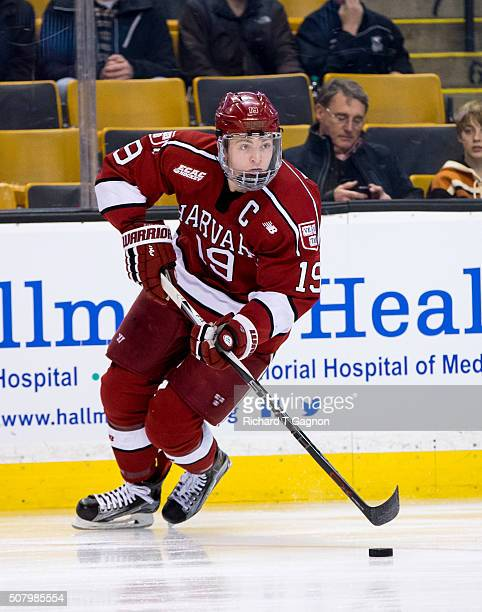 Jimmy Vesey of the Harvard Crimson controls the puck during NCAA hockey in the semifinals of the annual Beanpot Hockey Tournament against the Boston...