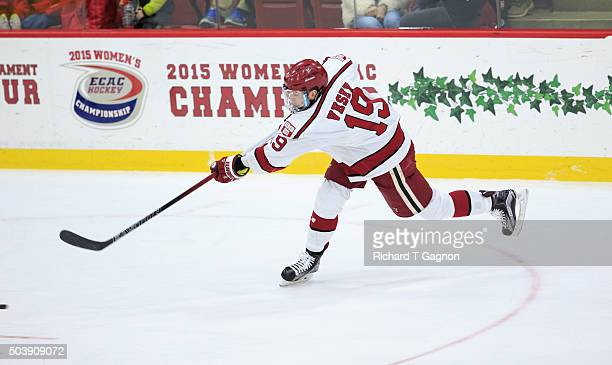 Jimmy Vesey of the Harvard Crimson takes a shot against the Boston University Terriers during NCAA hockey at The BrightLandry Hockey Center on...