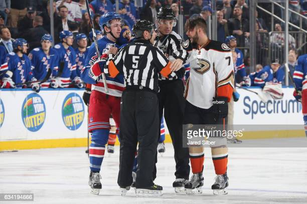 Jimmy Vesey of the New York Rangers and Joseph Cramarossa of the Anaheim Ducks battle after a whistle in the third period at Madison Square Garden on...