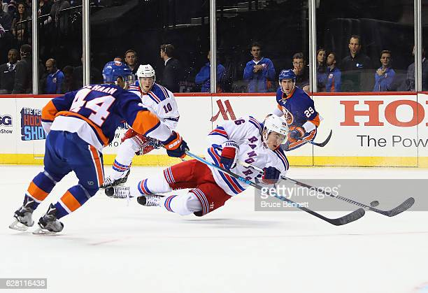 Jimmy Vesey of the New York Rangers gets the first period shot off against the New York Islanders at the Barclays Center on December 6 2016 in the...
