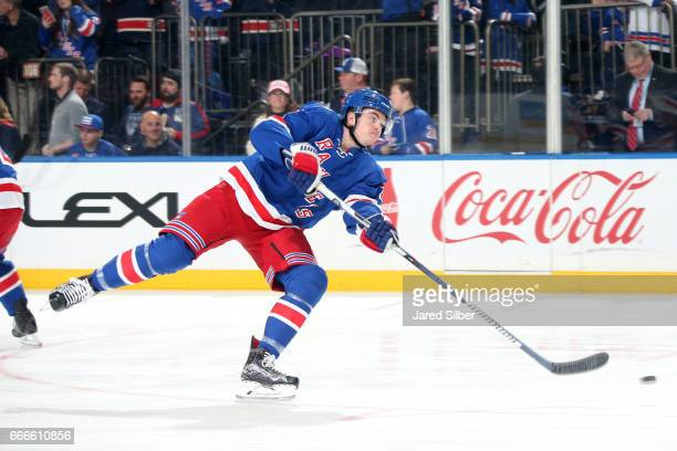 Jimmy Vesey of the New York Rangers shoots the puck during pregame warmups before the game against the Pittsburgh Penguins at Madison Square Garden...