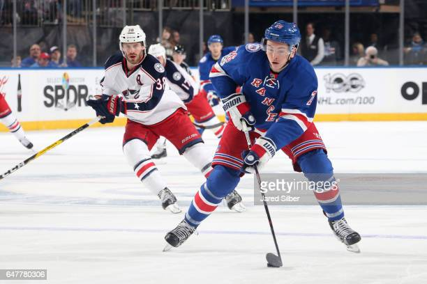 Jimmy Vesey of the New York Rangers skates with the puck against the Columbus Blue Jackets at Madison Square Garden on February 26 2017 in New York...