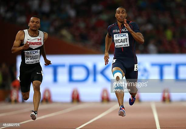 Jimmy Vicaut of France and Andre De Grasse of Canada compete in the Men's 100 metres heats during day one of the 15th IAAF World Athletics...