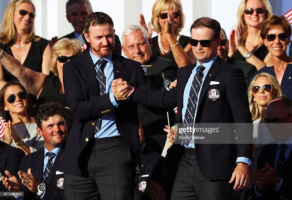 Jimmy Walker and Zach Johnson of the United States react on stage during the 2016 Ryder Cup Opening Ceremony at Hazeltine National Golf Club on September 29, 2016 in Chaska, Minnesota.