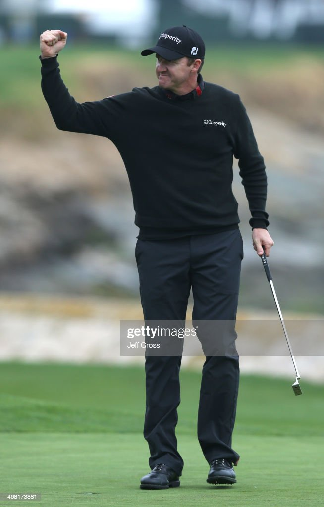 Jimmy Walker celebrates after making the final putt in the final round to win the AT&T Pebble Beach National Pro-Am at the Pebble Beach Golf Links on February 9, 2014 in Pebble Beach, California.