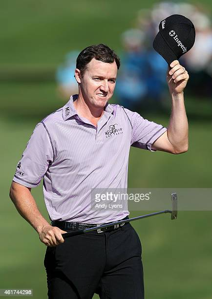 Jimmy Walker celebrates on the 18th green after winning the final round of the Sony Open In Hawaii at Waialae Country Club on January 18 2015 in...