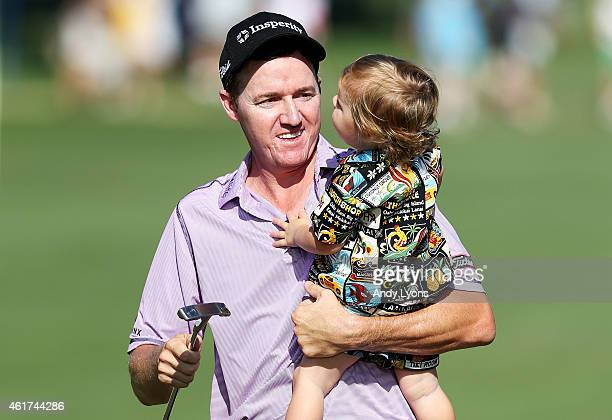 Jimmy Walker celebrates with his son after winning the final round of the Sony Open In Hawaii at Waialae Country Club on January 18 2015 in Honolulu...