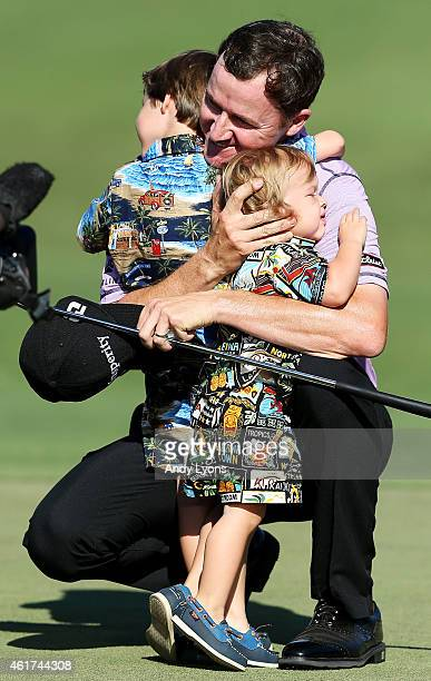 Jimmy Walker celebrates with his sons Mclain and Beckett after winning the final round of the Sony Open In Hawaii at Waialae Country Club on January...