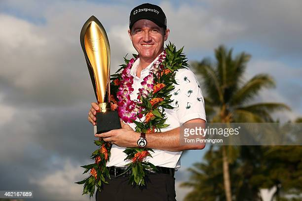 Jimmy Walker celebrates with the trophy after winning the the Sony Open in Hawaii at Waialae Country Club on January 12 2014 in Honolulu Hawaii