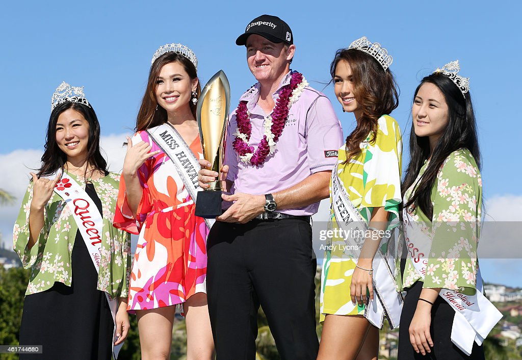 Jimmy Walker celebrates with the winner's trophy after the final round of the Sony Open In Hawaii at Waialae Country Club on January 18, 2015 in Honolulu, Hawaii.