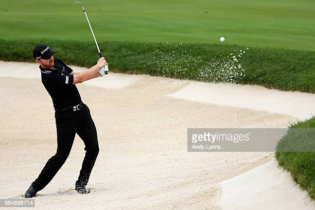 Jimmy Walker of the United States celebrates chipping in for birdie from a greenside bunker on the tenth hole during the final round of the 2016 PGA...