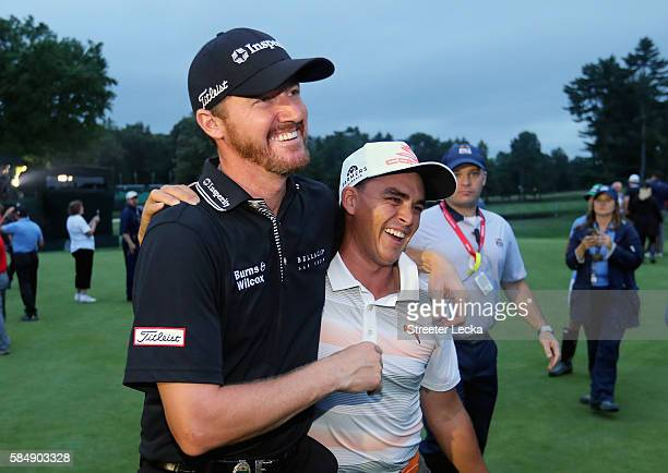 Jimmy Walker of the United States celebrates his victory with Rickie Fowler after the final round of the 2016 PGA Championship at Baltusrol Golf Club...