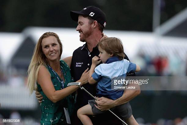 Jimmy Walker of the United States celebrates with his wife Erin and son Beckett after making par on the 18th hole to win the 2016 PGA Championship at...