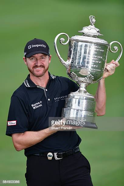 Jimmy Walker of the United States celebrates with the Wanamaker Trophy after winning the 2016 PGA Championship at Baltusrol Golf Club on July 31 2016...