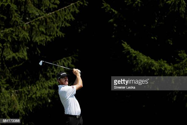 Jimmy Walker of the United States hits an approach shot on the seventh hole during the first round of the 2016 PGA Championship at Baltusrol Golf...