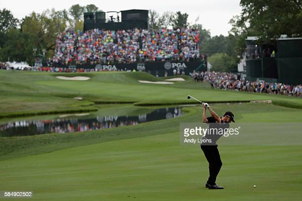 Jimmy Walker of the United States hits his second shot on the 18th hole during the final round of the 2016 PGA Championship at Baltusrol Golf Club on...