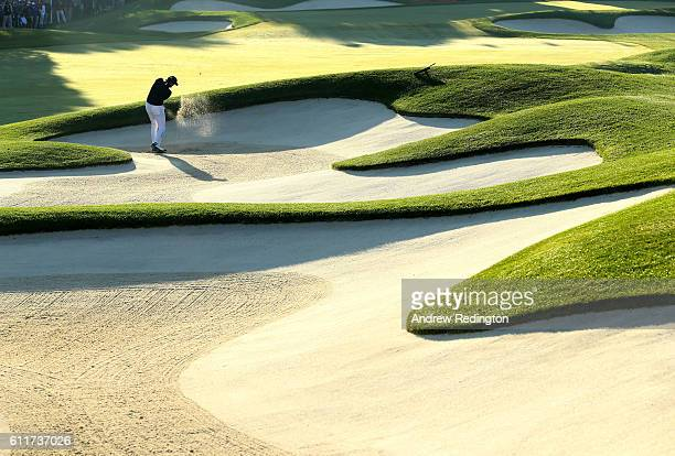 Jimmy Walker of the United States hits out of a bunker on the first hole during morning foursome matches of the 2016 Ryder Cup at Hazeltine National...
