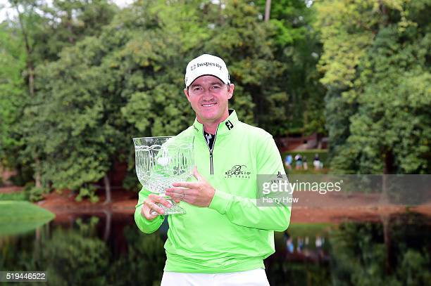 Jimmy Walker of the United States holds the winner's trophy after the Par 3 Contest prior to the start of the 2016 Masters Tournament at Augusta...