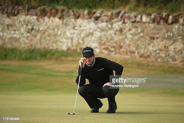 Jimmy Walker of the United States lines up a putt during the first round of the 142nd Open Championship at Muirfield on July 18 2013 in Gullane...