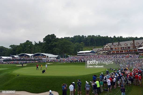 Jimmy Walker of the United States places his ball on the 18th green during the final round of the 2016 PGA Championship at Baltusrol Golf Club on...