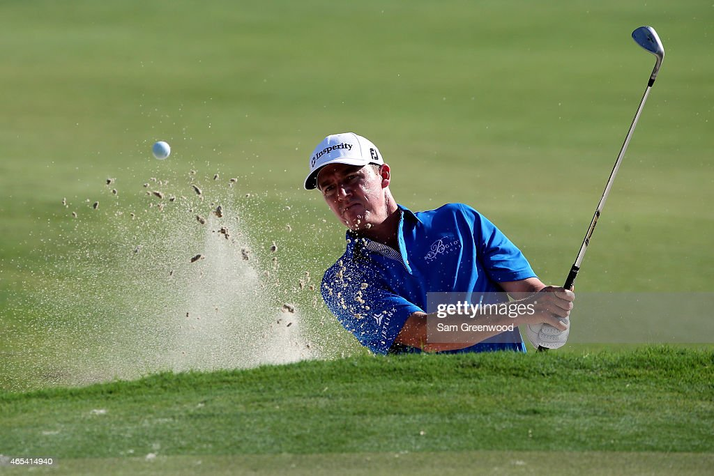 Jimmy Walker of the United States plays a shot on the 12th hole during the second round of the World Golf Championships-Cadillac Championship at Trump National Doral Blue Monster Course on March 6, 2015 in Doral, Florida.