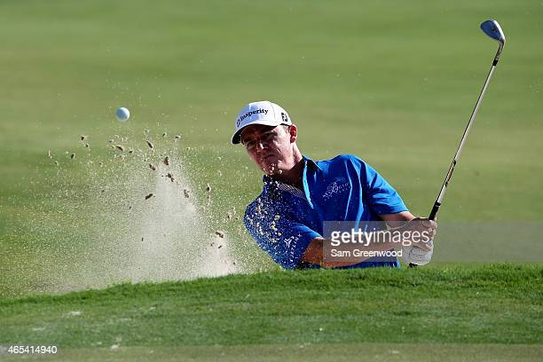 Jimmy Walker of the United States plays a shot on the 12th hole during the second round of the World Golf ChampionshipsCadillac Championship at Trump...