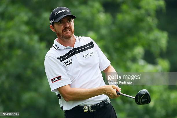 Jimmy Walker of the United States plays his shot from the third tee during the continuation of the weather delayed third round of the 2016 PGA...