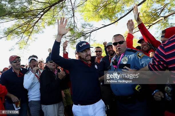 Jimmy Walker of the United States reacts after a shot from the crowd on the seventh hole during morning foursome matches of the 2016 Ryder Cup at...