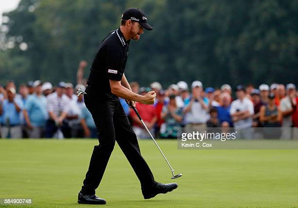 Jimmy Walker of the United States reacts to his birdie putt on the 17th hole during the continuation of the final round of the 2016 PGA Championship...