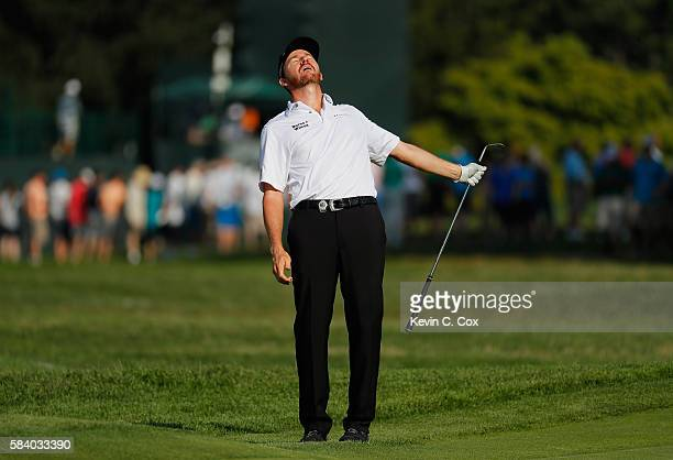 Jimmy Walker of the United States reacts to his chip shot on the 12th hole during the first round of the 2016 PGA Championship at Baltusrol Golf Club...