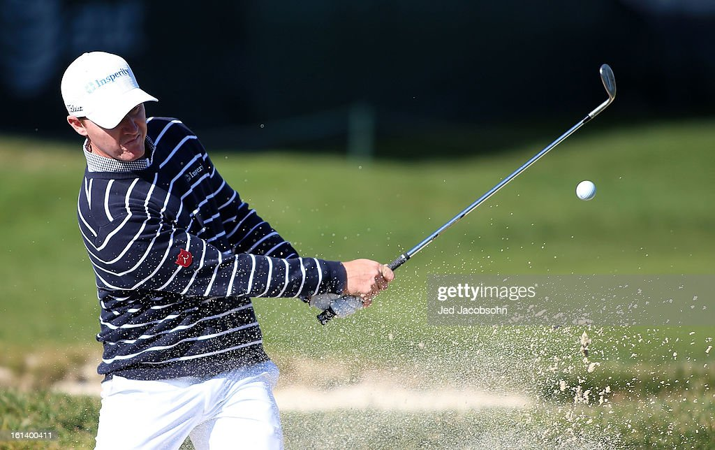 Jimmy Walker plays a bunker shot on the 17th hole during the final round of the AT&T Pebble Beach National Pro-Am at Pebble Beach Golf Links on February 10, 2013 in Pebble Beach, California.