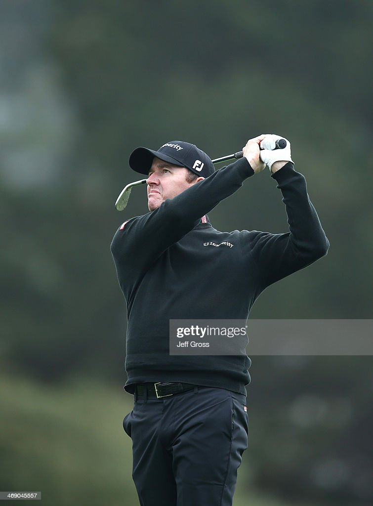 Jimmy Walker plays a shot during the final round of the AT&T Pebble Beach National Pro-Am at the Pebble Beach Golf Links on February 9, 2014 in Pebble Beach, California.