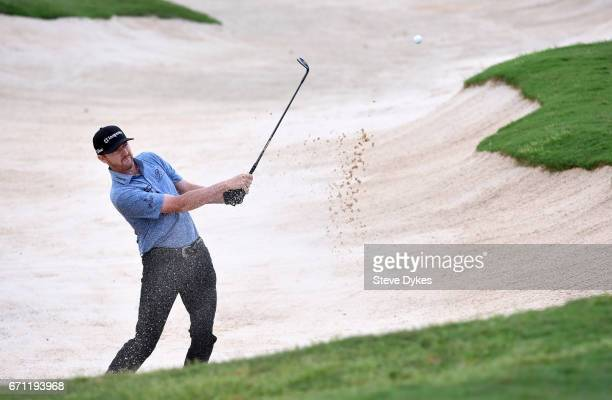 Jimmy Walker plays his shot out of the bunker on the 15th hole during the second round of the Valero Texas Open at TPC San Antonio ATT Oaks Course on...