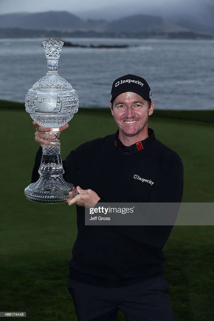 Jimmy Walker poses with the trophy after winning the AT&T Pebble Beach National Pro-Am at the Pebble Beach Golf Links on February 9, 2014 in Pebble Beach, California.