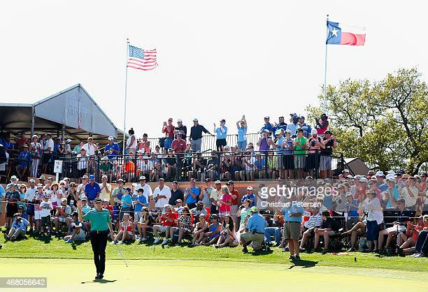 Jimmy Walker reacts after a birdie putt on the 16th green during the final round of the Valero Texas Open at TPC San Antonio ATT Oaks Course on March...
