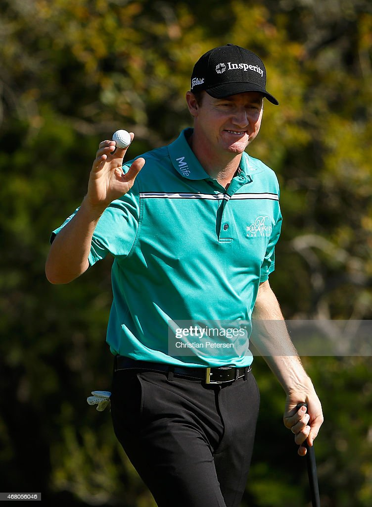 Jimmy Walker reacts after a birdie putt on the 17th green during the final round of the Valero Texas Open at TPC San Antonio AT&T Oaks Course on March 29, 2015 in San Antonio, Texas.