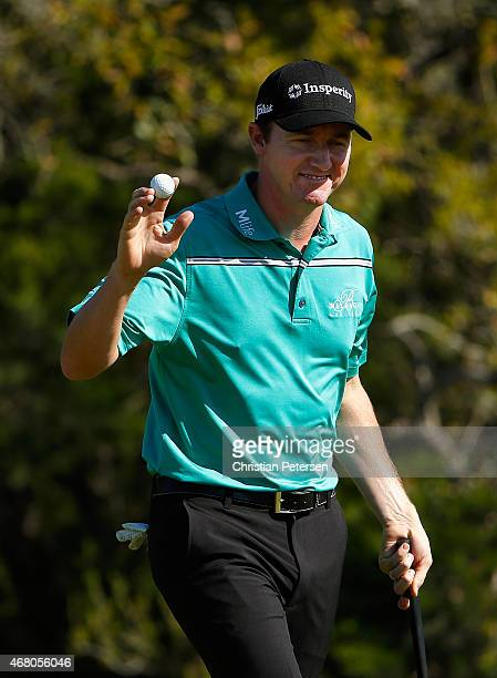 Jimmy Walker reacts after a birdie putt on the 17th green during the final round of the Valero Texas Open at TPC San Antonio ATT Oaks Course on March...