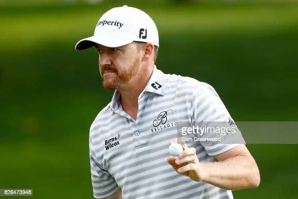 Jimmy Walker reacts on the 18th green during the second round of the World Golf Championships Bridgestone Invitational at Firestone Country Club...