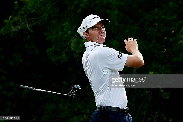 Jimmy Walker releases his driver after hitting a tee shot on the 12th hole during Round Two of the ATT Byron Nelson at the TPC Four Seasons Resort...