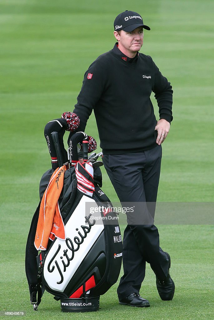 Jimmy Walker stands with his bag on the second hole fairway during the final round of the AT&T Pebble Beach National Pro-Am at the Pebble Beach Golf Links on February 9, 2014 in Pebble Beach, California.
