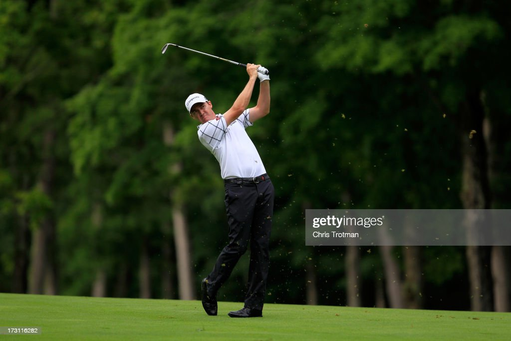 Jimmy Walker watches his second shot on the sixth hole during the final round of the Greenbrier Classic at the Old White TPC on July 7, 2013 in White Sulphur Springs, West Virginia.