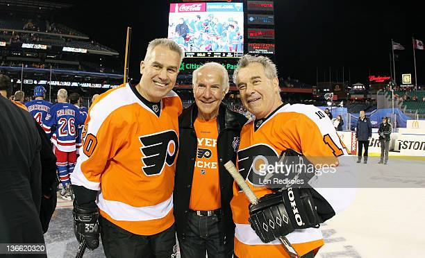 Jimmy Watson Chairman Ed Snider and Joe Watson of the Philadelphia Flyers pose for a photo after defeating the New York Rangers 31 following the...