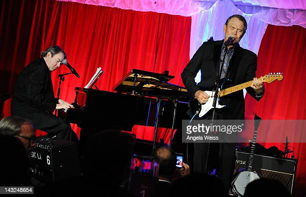 Jimmy Webb and Glen Campbell perform at Jane Seymour's 2nd annual Open Hearts Foundation Celebration held at a private residency on April 21 2012 in...