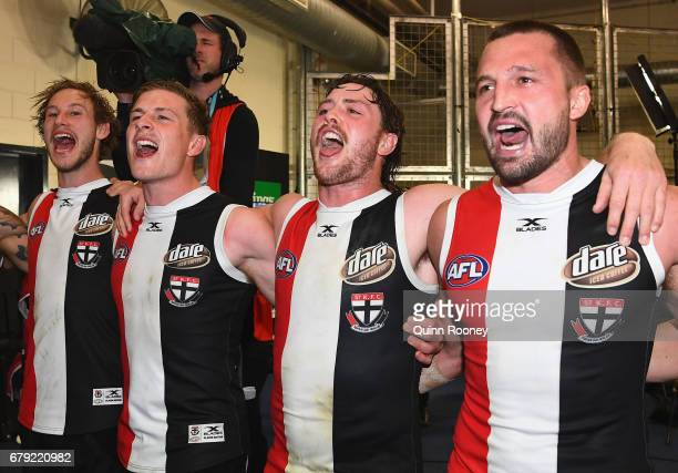 Jimmy Webster Jack Newnes Jack Steven and Jarryn Geary of the Saints sing the song after winning the round seven AFL match between the St Kilda...