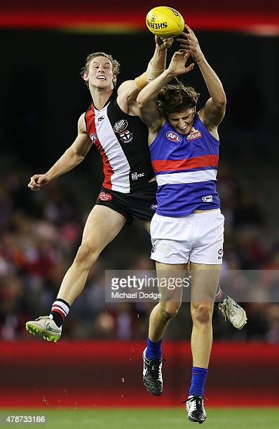 Jimmy Webster of the Saints competes for the ball Marcus Bontempelli of the Bulldogs during the round 13 AFL match between the St Kilda Saints and...