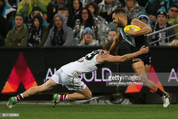 Jimmy Webster of the Saints tackles Jarman Impey of the Power during the 2017 AFL round 19 match between the Port Adelaide Power and the St Kilda...