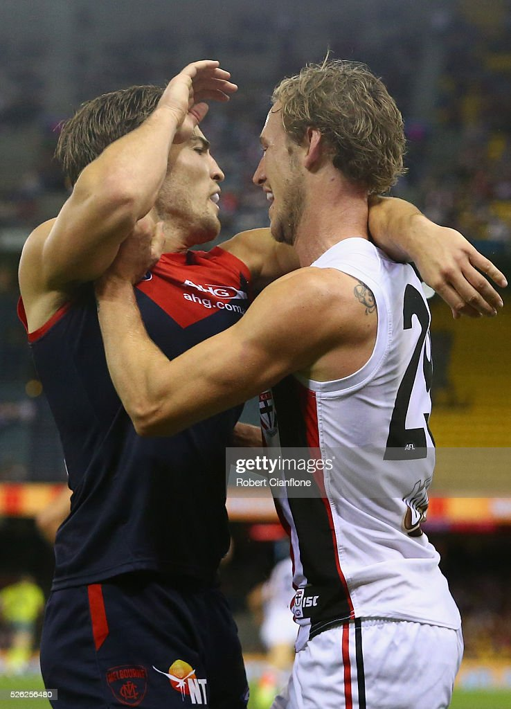 Jimmy Webster of the Saints wrestles with Jack Viney of the Demons during the round six AFL match between the Melbourne Demons and the St Kilda Saints at Etihad Stadium on April 30, 2016 in Melbourne, Australia.