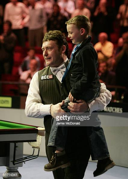 Jimmy White of England celebrates victory with his son Tommy Tiger White during his quarterfinal match against Mark Williams of Wales during The...