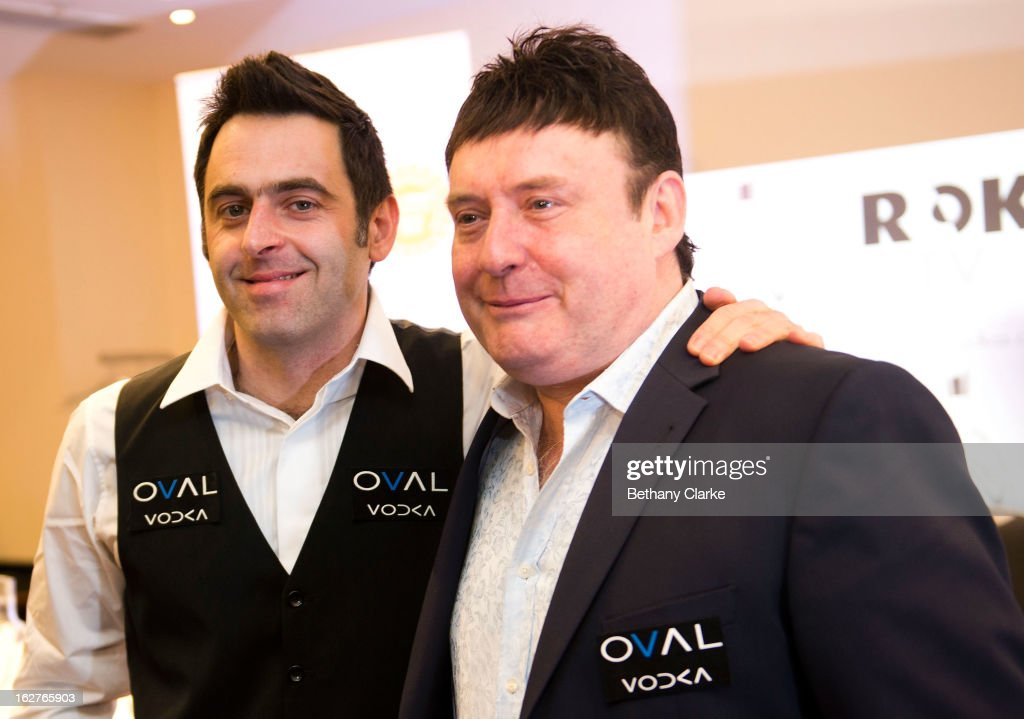 Jimmy White (R) poses with Ronnie O'Sullivan speaks during a press conference at Hilton London Metropole on February 26, 2013 in London, England. Reigning World Snooker Champion Ronnie O'Sullivan announced his comeback ahead of the upcoming World Snooker Championships in Sheffield in April 2013.