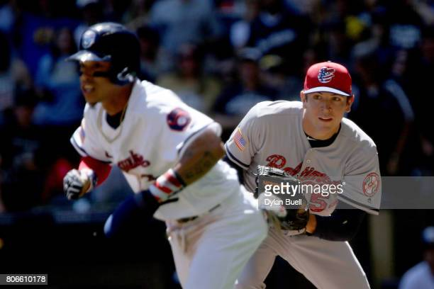 Jimmy Yacabonis of the Baltimore Orioles chases after Orlando Arcia of the Milwaukee Brewers during a run down in the third inning at Miller Park on...